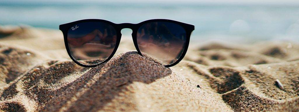 Sunglasses-Beach-Sand-Pile-1280x480-1024x384